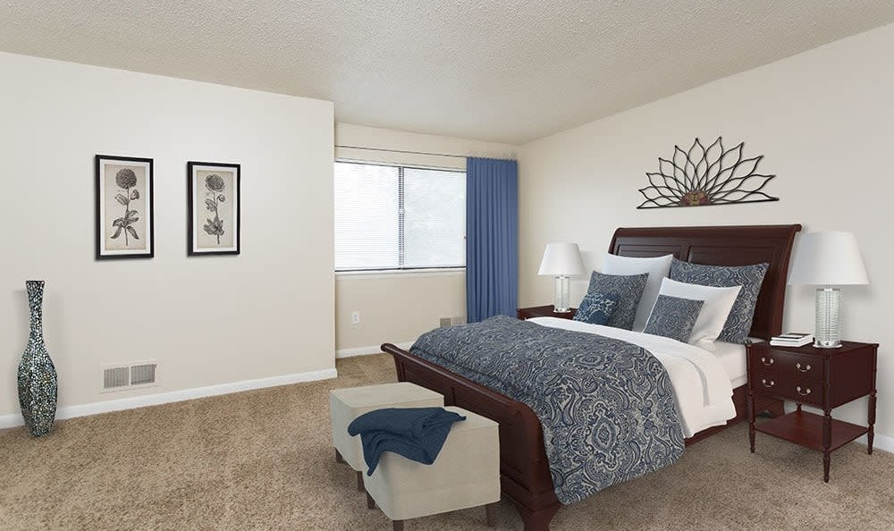 Spacious master bedroom at Crossroads Apartments in Spencerport, New York