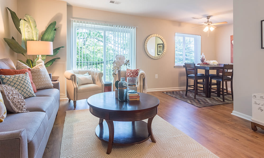 Spacious living room with wood-style flooring at Eagle's Crest Apartments in Harrisburg, Pennsylvania
