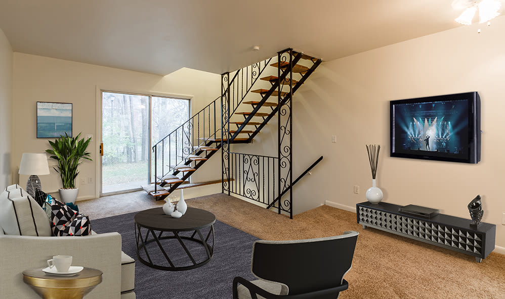 Living room with wood-style flooring at Elmwood Terrace Apartments & Townhomes in Rochester, New York