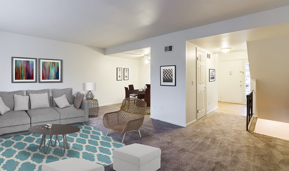 Spacious, bright living room at Elmwood Terrace Apartments & Townhomes in Rochester, New York