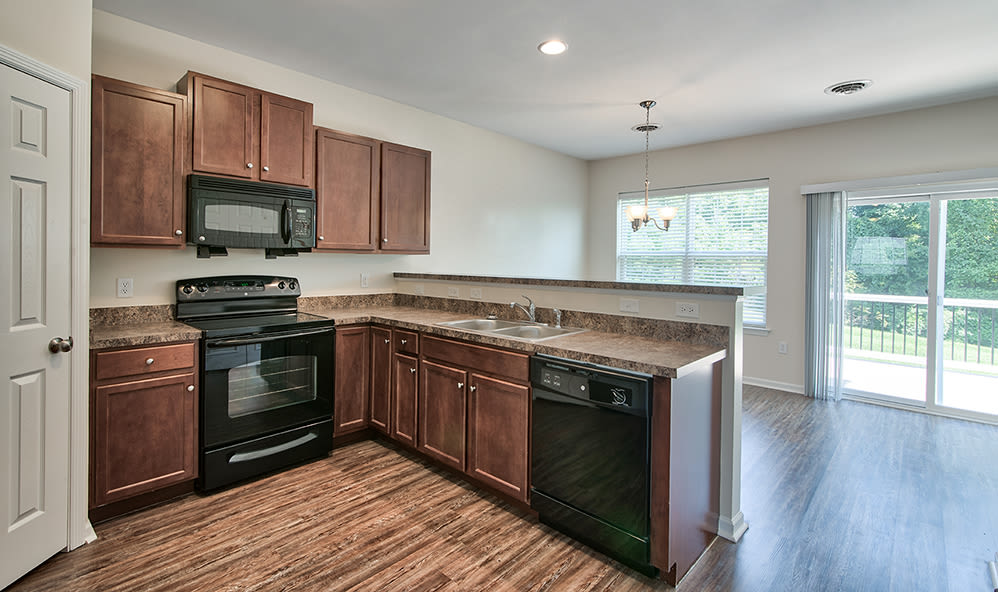 Kitchen with wood-style flooring at Emerald Pointe Townhomes in Harrisburg, Pennsylvania