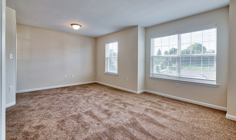 Bedroom with plush carpet at Emerald Pointe Townhomes in Harrisburg, Pennsylvania