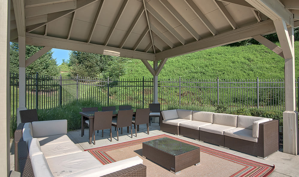 Poolside lounge area at Emerald Pointe Townhomes in Harrisburg, Pennsylvania