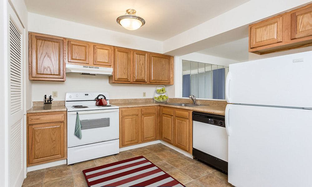 Bright, spacious kitchen at Emerald Springs Apartments in Painted Post, New York