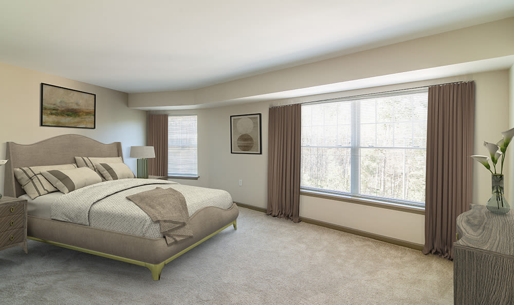 Beautifully designed bedroom at Greenwood Cove Apartments home in Rochester, New York