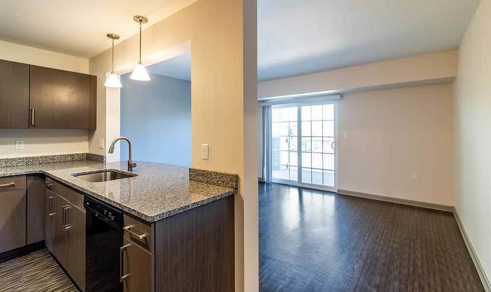 Kitchen with granite countertops at Greenwood Cove Apartments in Rochester, New York