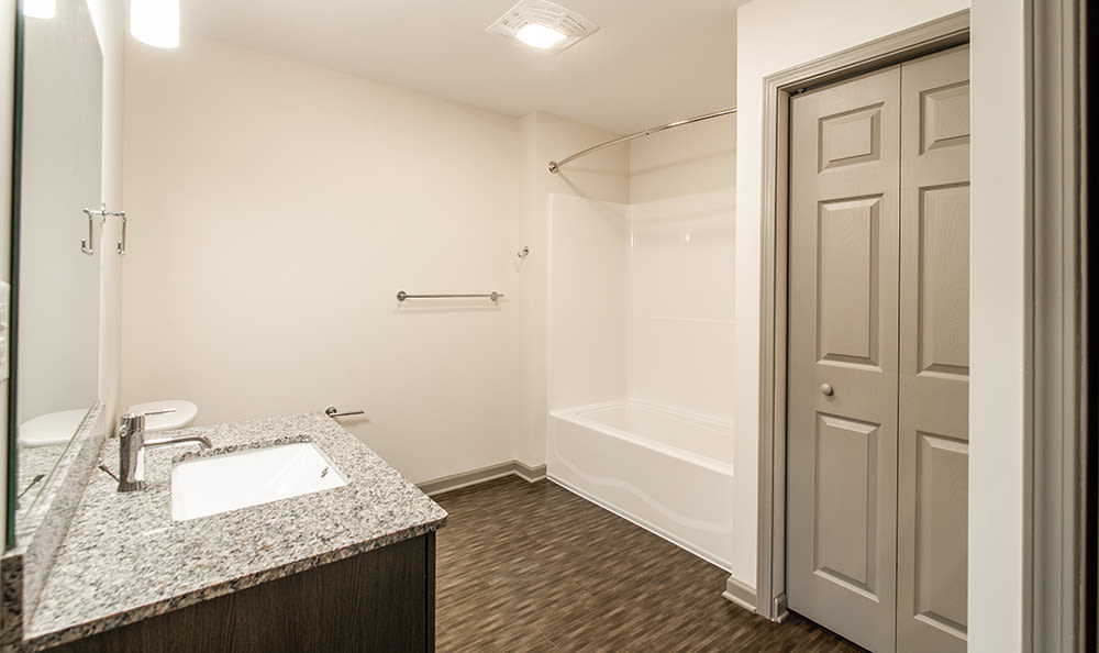 Bright bathroom at Greenwood Cove Apartments in Rochester, New York