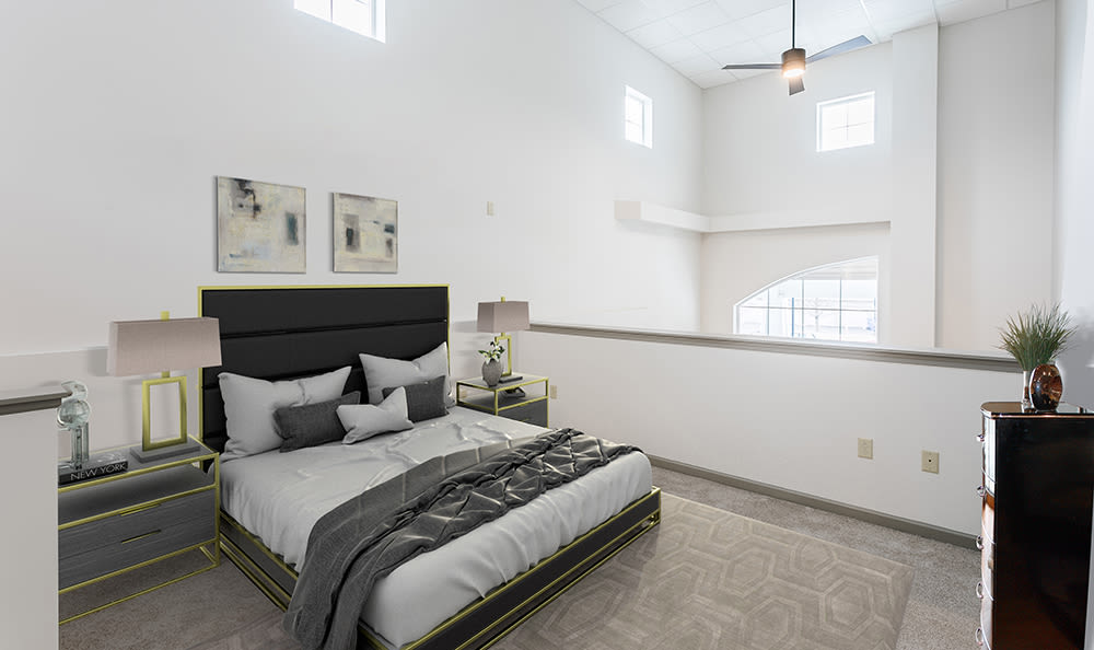 Modern, stylish bedroom at Greenwood Cove Apartments in Rochester, New York