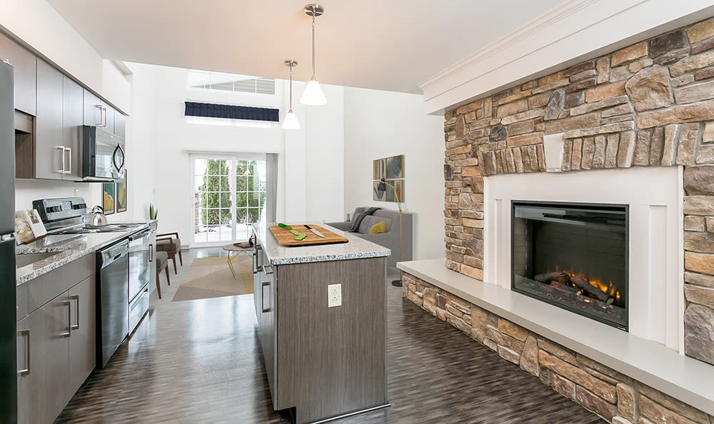 Kitchen with a fireplace at Greenwood Cove Apartments in Rochester, New York