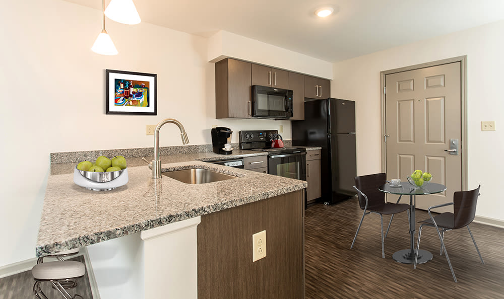 Bright, spacious kitchen at Greenwood Cove Apartments in Rochester, New York