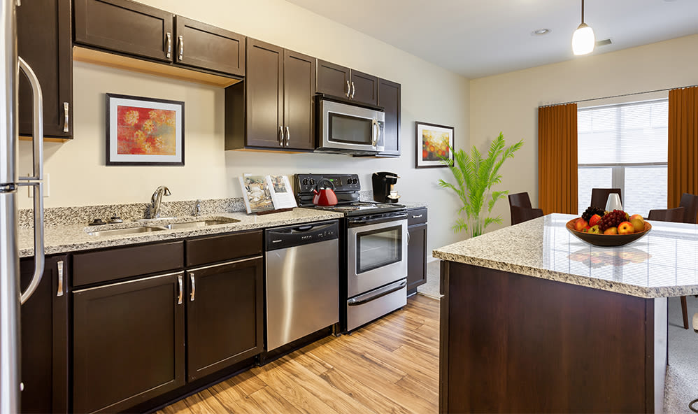 Fully equipped kitchen at Ethan Pointe Apartments home in Rochester, New York