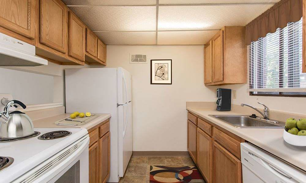 Fully-equipped kitchen at High Acres Apartments & Townhomes in Syracuse, New York