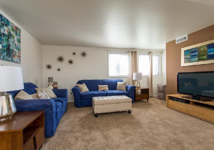 Bright, cozy living room at Idylwood Resort Apartments in Cheektowaga, New York