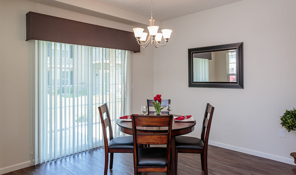 Dining room at Auburn Creek Apartments home in Victor, New York
