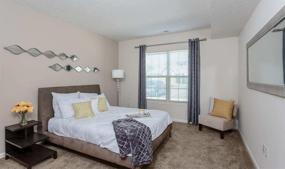 Well decorated bedroom at Auburn Creek Apartments home in Victor, New York