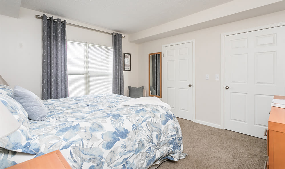 Our apartments at Auburn Creek Apartments in Victor, New York showcase a modern bedroom