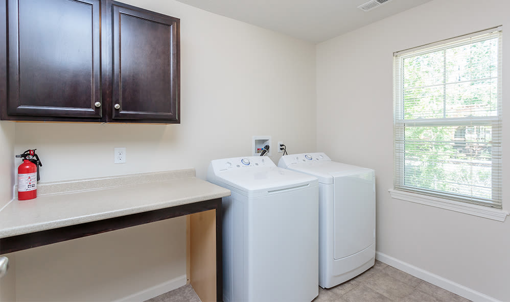 Washer and dryer at Auburn Creek Apartments home in Victor, New York