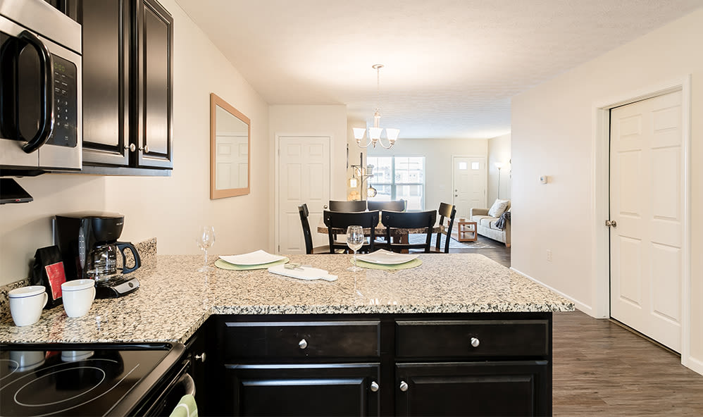 Kitchen and dining room at Auburn Creek Apartments in Victor, New York