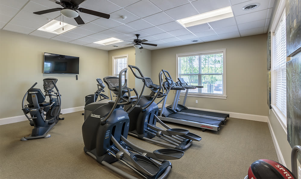 Fitness center at Auburn Creek Apartments in Victor, New York