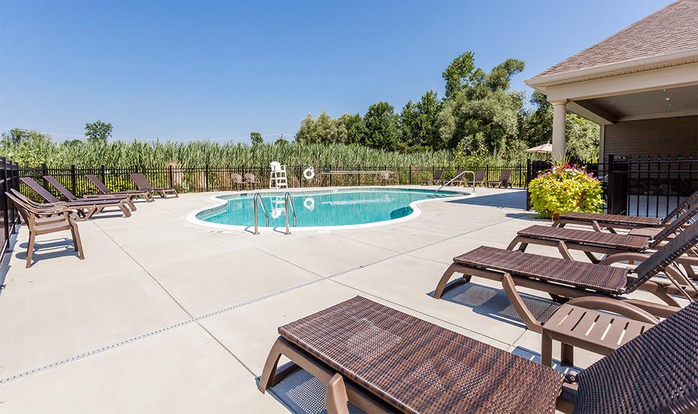 Auburn Creek Apartments pool deck in Victor, New York