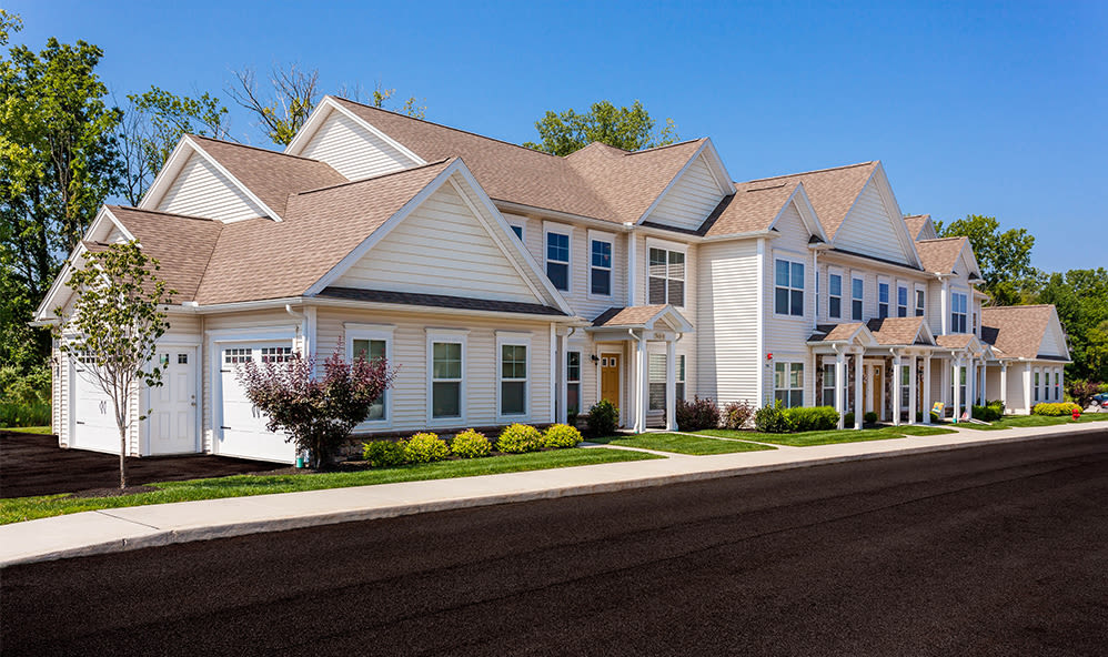 Front exterior view of apartment townhomes at Auburn Creek Apartments in Victor, New York