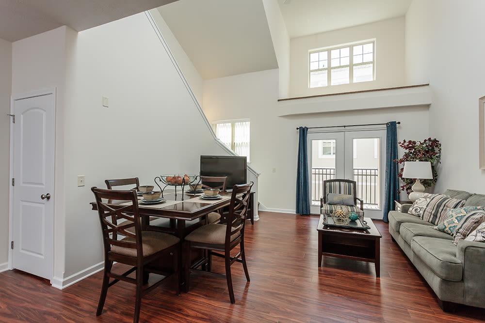 Living room and dining table view at Gateway Landing on the Canal in Rochester, New York