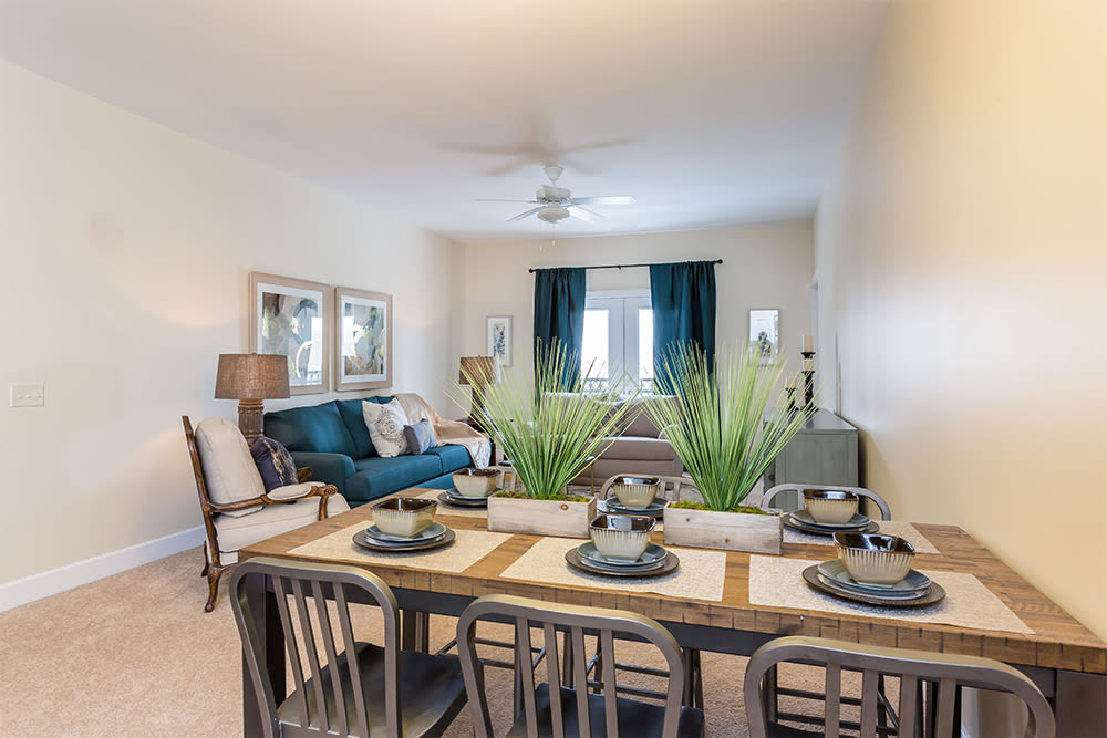 Living room and dining area at Gateway Landing on the Canal home in Rochester, New York