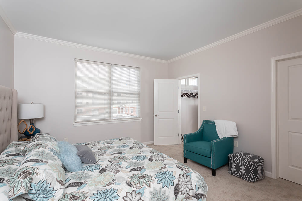 Spacious, cozy bedroom at North Ponds Apartments in Webster, New York