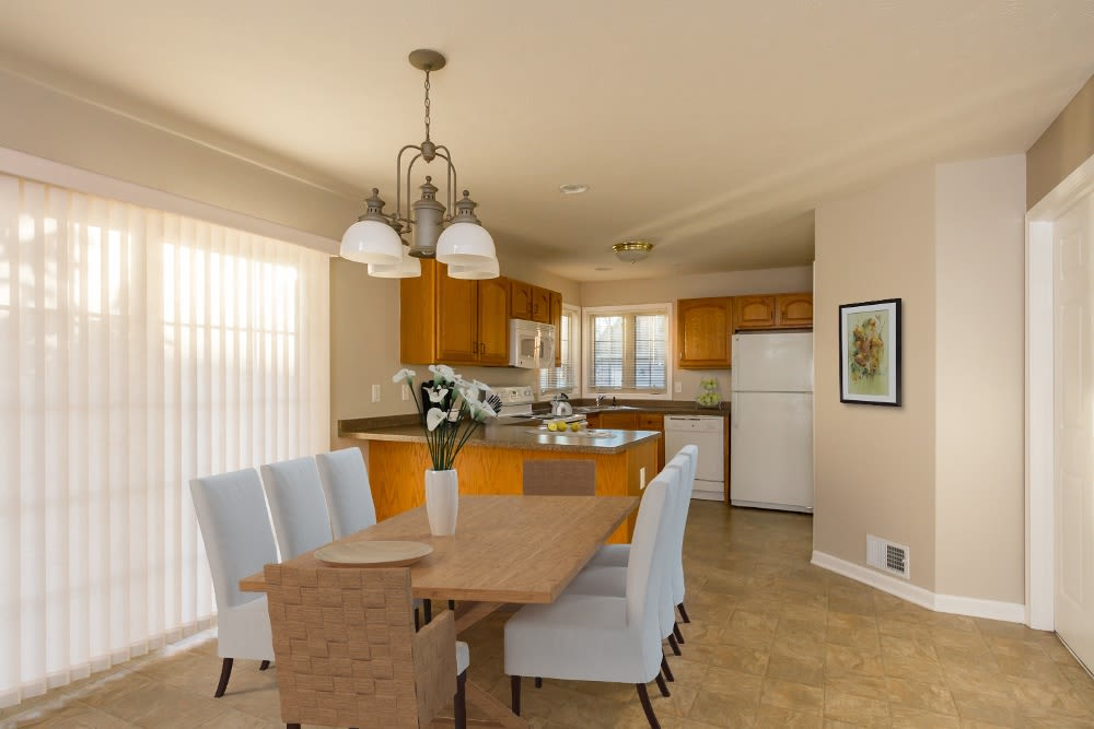 Elegant dining room at North Ponds Apartments home in Webster, New York