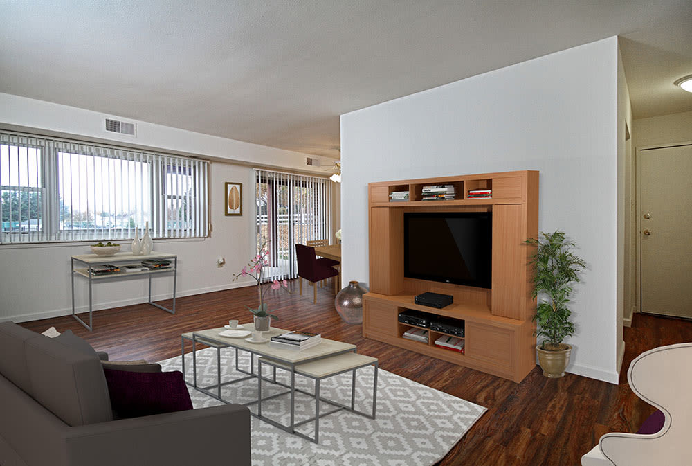Bright, spacious living room at King's Manor Apartments in Harrisburg, Pennsylvania