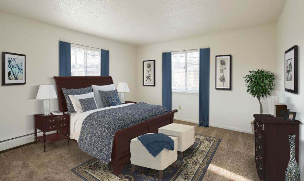 Large, modern bedroom at Knollwood Manor Apartments in Fairport, New York