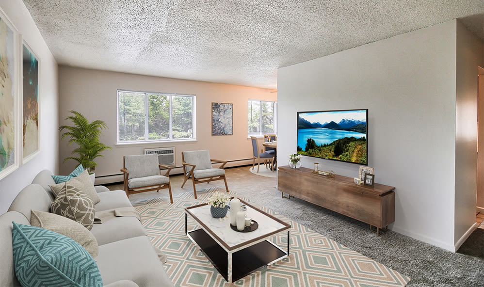 Naturally will-lit living room at Knollwood Manor Apartments in Fairport, New York