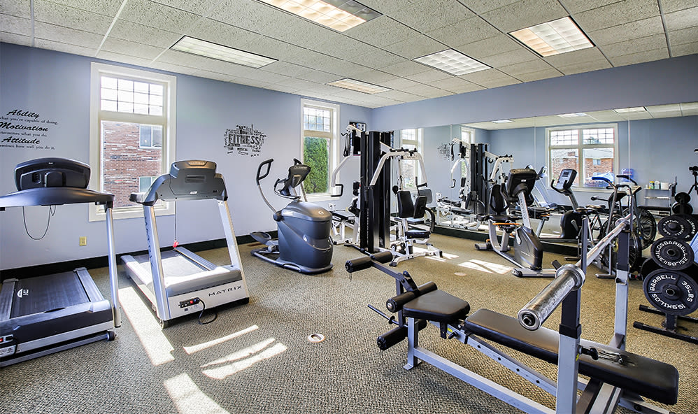 Fitness center at Knollwood Manor Apartments in Fairport, New York