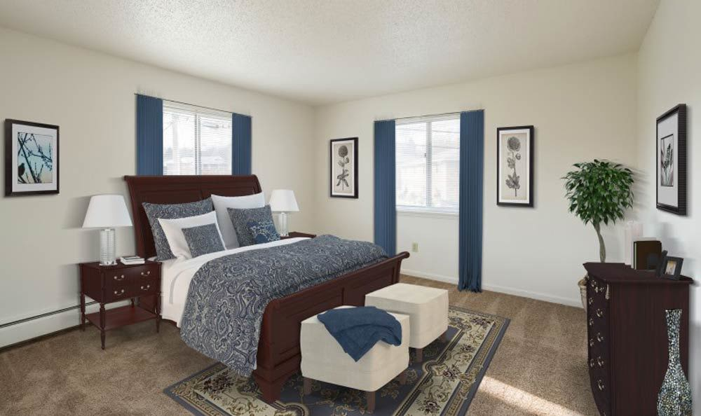 Modern bedroom at Knollwood Manor Apartments in Fairport, New York