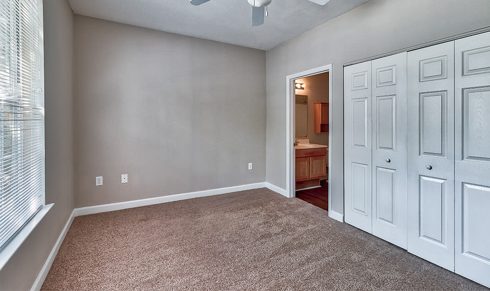 Spacious bedroom with a large closet at Main Street Apartments in Huntsville, Alabama
