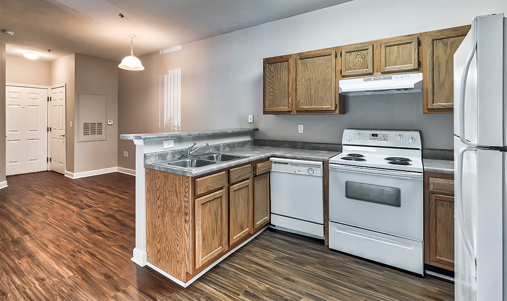 Open floor plan space and well-equipped kitchen at Main Street Apartments home in Huntsville, Alabama