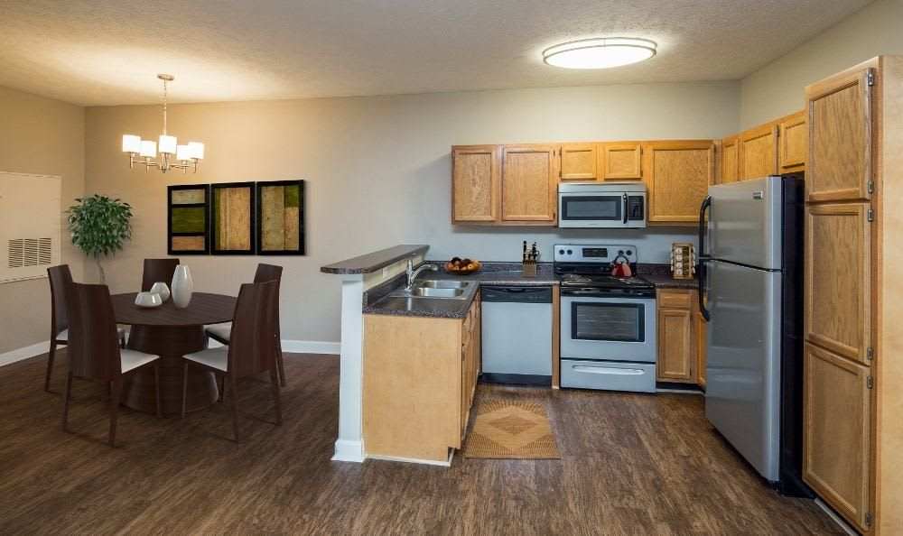 Dining room and kitchen view at Main Street Apartments home in Huntsville, Alabama
