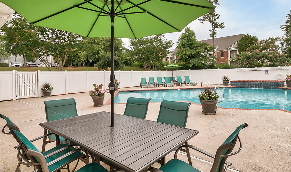 Poolside seating at Main Street Apartments in Huntsville, Alabama