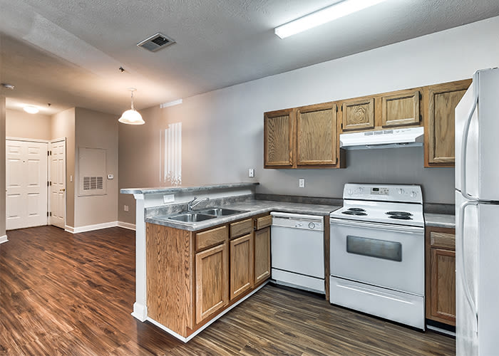 Kitchen with wood-style flooring at Main Street Apartments in Huntsville, Alabama
