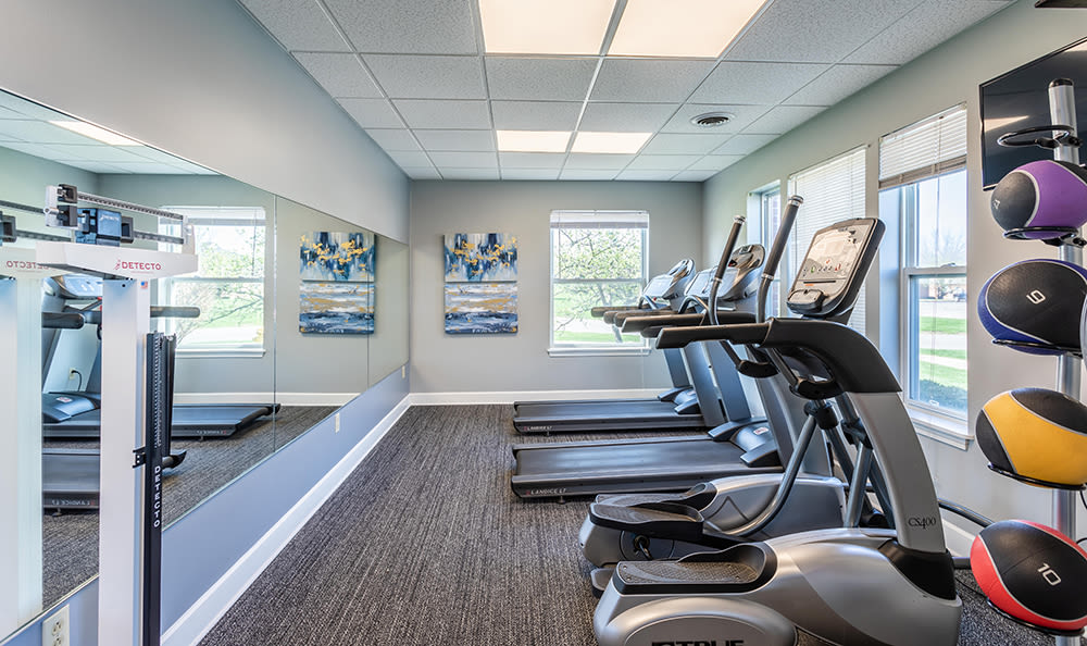 Modern fitness center at Maplewood Estates Apartments in Hamburg, New York