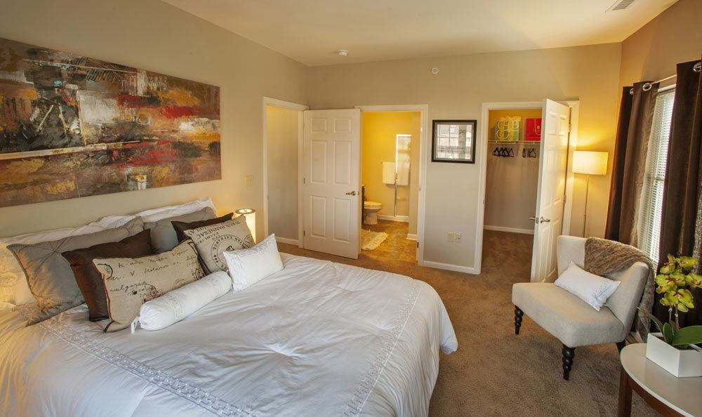Well decorated bedroom at Rochester Village Apartments at Park Place in Cranberry Township, Pennsylvania