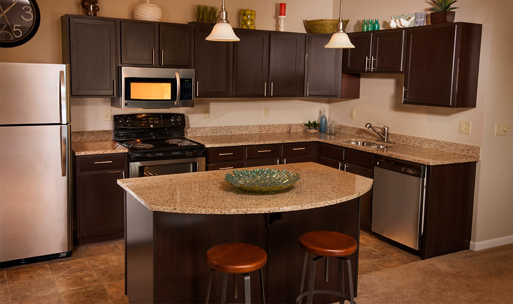 Fully-equipped kitchen at Rochester Village Apartments at Park Place in Cranberry Township, Pennsylvania