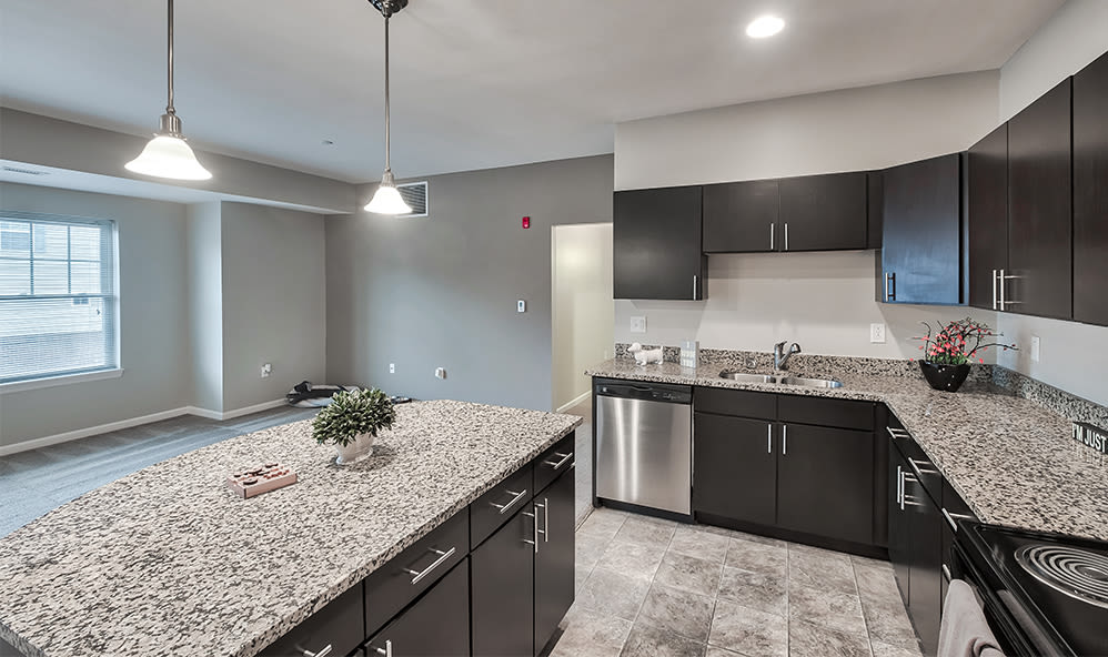 Spacious kitchen with granite counters at Rochester Village Apartments at Park Place in Cranberry Township, Pennsylvania