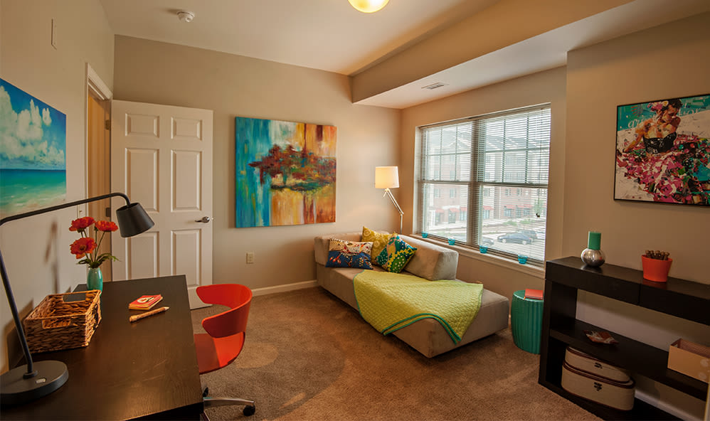 Well-lit bedroom at Rochester Village Apartments at Park Place in Cranberry Township, Pennsylvania