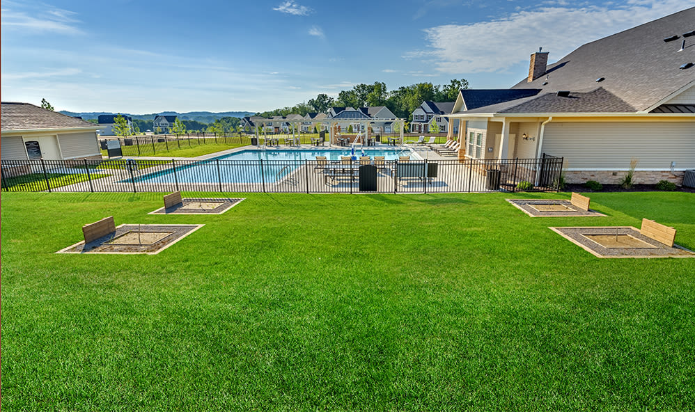 Lawn by the swimming pool at Rochester Village Apartments at Park Place in Cranberry Township, Pennsylvania