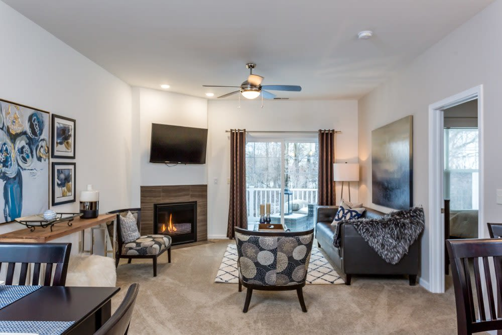 Spacious living room with a ceiling fan at The Links at CenterPointe Townhomes in Canandaigua, New York