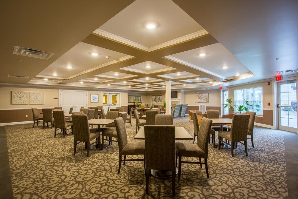 Community dining area at The Marquis at the Woods in Webster, New York