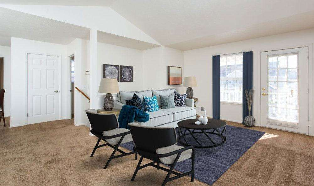 Beautifully designed living room at Westview Commons Apartments in Rochester, New York