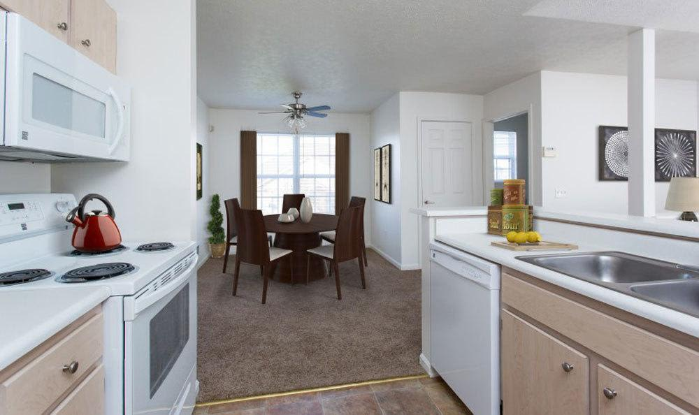 Kitchen and dining area view at Westview Commons Apartments home in Rochester, New York