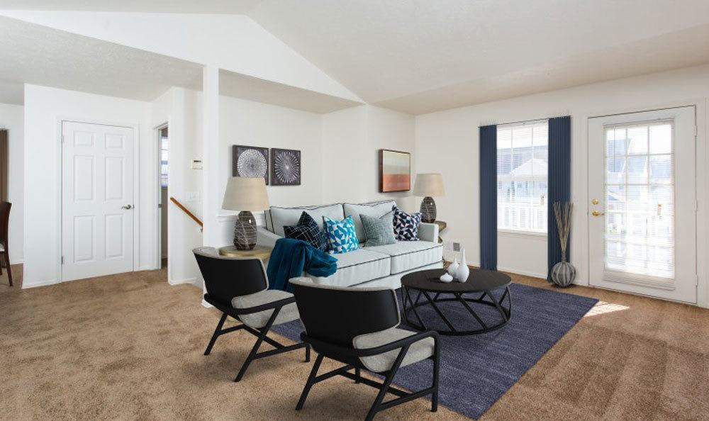 Bright, spacious living room at Westview Commons Apartments home in Rochester, New York